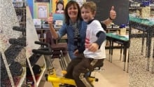 Teacher Bev Ross and student with stationary bike