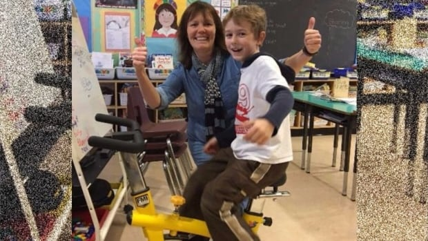 A student tries one of the first four stationary bikes at Strawberry Vale elementary school in Victoria alongside teacher Bev Ross. With 10 more on the way, soon every classroom will have a bike.