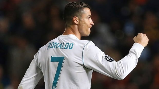 Real Madrid's Cristiano Ronaldo celebrates after scoring during a Champions League Group H soccer match between APOEL Nicosia and Real Madrid at GSP stadium, in Nicosia, on Tuesday.