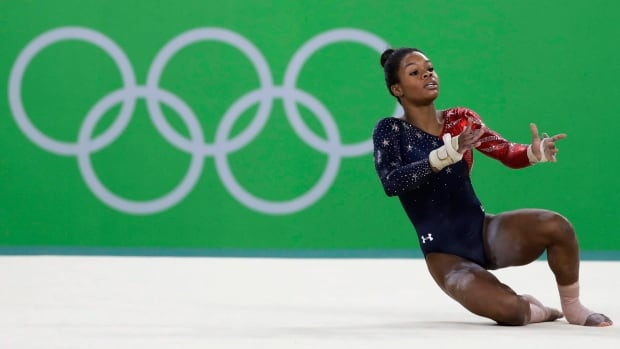 "United States' Gabrielle ""Gabby"" Douglas performs on the floor during the artistic gymnastics women's qualification at the 2016 Summer Olympics in Rio de Janeiro, Brazil."