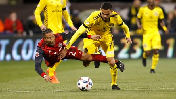 TFC's Justin Morrow, left, battles Artur of the Columbus Crew during their 0-0 draw in the first leg of their MLS semifinal on Tuesday.