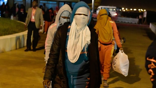 Ivorian migrants returning from Libya arrive at the airport in Abidjan, Ivory Coast, on Monday. Some 155 Ivorian migrants were repatriated and returned to their country from Libya, the site of camps that have drawn international condemnation.