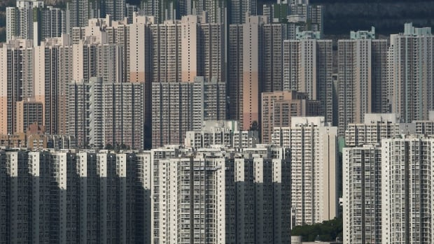 Despite a decades-long public and private building boom, Hong Kong continues to face a housing crisis of its own as prices soar, but the city's dynamism attracts more new arrivals.