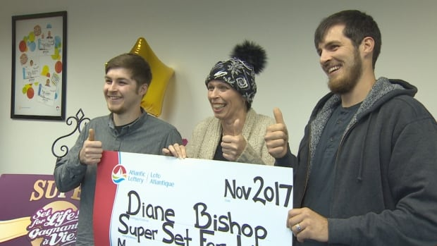 Diane Bishop made picking up the mock cheque for her $1.5-million Super Set for Life lottery win a family event: her sons, Shane, left, and Jordan Parsons joined her at the Atlantic Lottery office in St. John's recently.