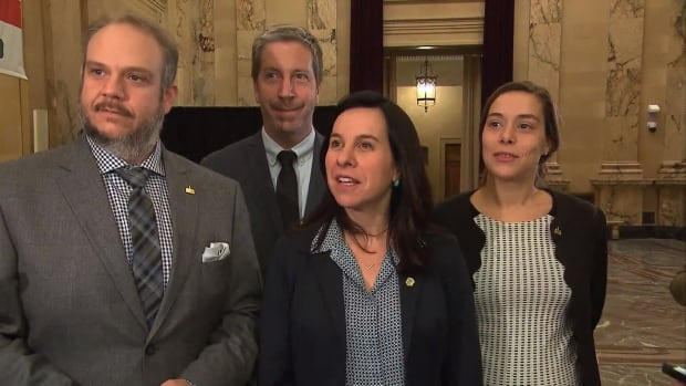 Valérie Plante, centre, stands with Projet Montréal's Benoit Dorais, far left, François Limoges and Laurence Lavigne Lalonde after their first executive committee meeting Wednesday.