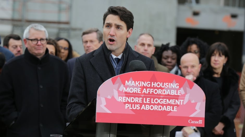 Prime Minister Justin Trudeau, centre, announces the Liberal government's National Housing Strategy in Toronto on Nov. 22, 2017.