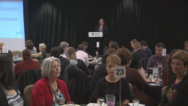 Affordable housing advocates celebrate National Housing Day at a luncheon on Wednesday.