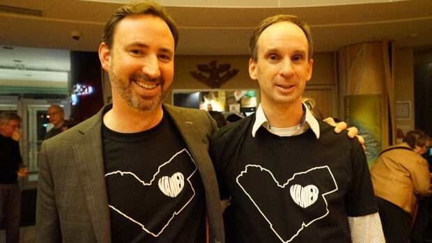 """Mark Kaluski (left), Quartier Vanier BIA chair, and Drew Dobson, organizer of SOS Vanier, model """"heart of the heart"""" T-shirts meant to show support for the Vanier community."""