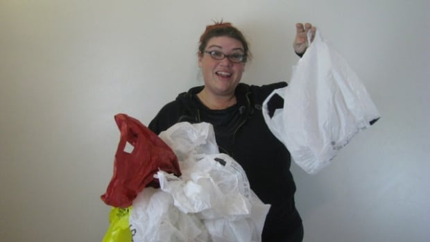 Ray Eskritt holds plastic shopping bags, which she hopes people will crochet into sleeping mats for homeless people at an event on Dec. 3.