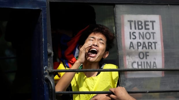 An exile Tibetan shouts slogans while being taken away in a police vehicle after a protest near the Chinese embassy in New Delhi, India, Oct. 18, 2017. China does not take kindly to foreign governments giving attention to the Tibet issue. That includes meeting the Dalai Lama or his political leaders.