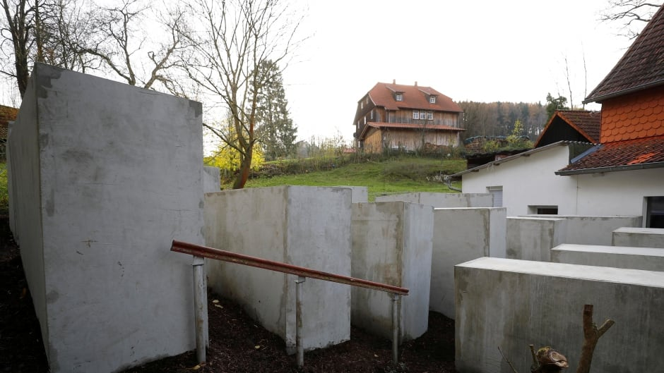 A pared-down version of Berlin's Holocaust memorial built by a German political art group, is seen next to the home of Bjoern Hoecke, a senior member of the anti-immigrant Alternative for Germany (AFD) party, in the village of Bornhagen, Germany.