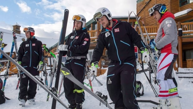 Members of the Austrian ski team are seen heading up the mountain for course inspection in Lake Louise, Alta. on Wednesday. Training runs for the men's alpine World Cup event were cancelled for the second day in a row on Thursday.