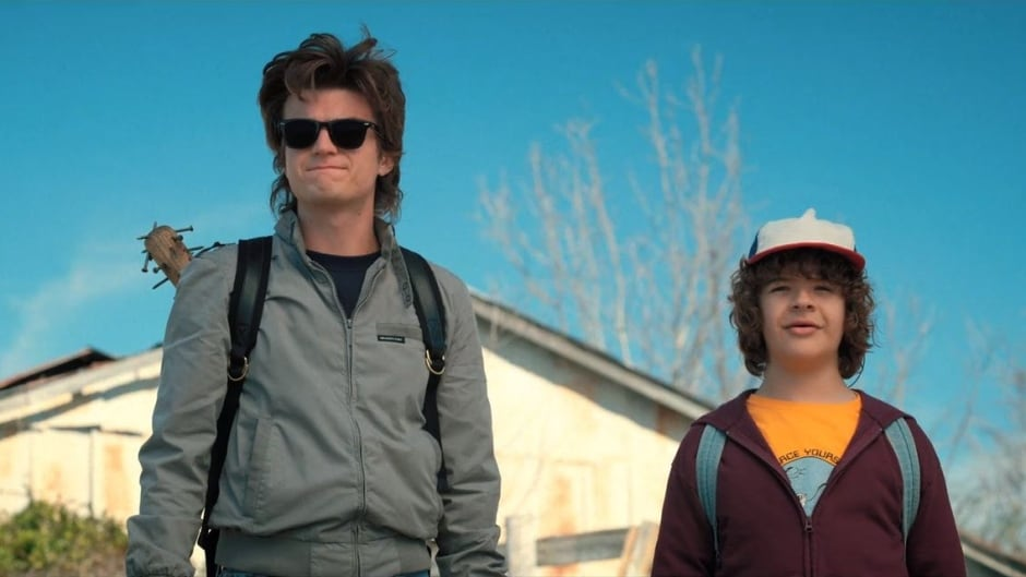 Gaten Matarazzo, right, who plays Dustin on Stranger Things, sported a Missouri orthodontist's T-shirt design in the the fifth and sixth episodes of the Netflix series' second season.