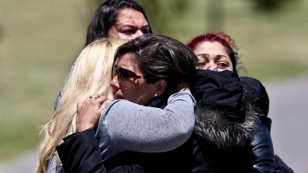Relatives of missing submarine crew member Celso Oscar Vallejo, react to the news that a sound detected during the search for the ARA San Juan submarine is consistent with that of an explosion, at the Mar de Plata Naval Base in Argentina on Thursday.