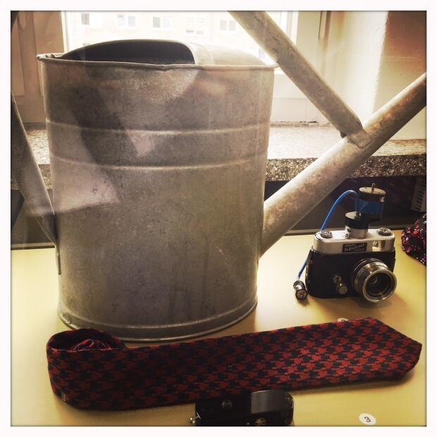 373 Stasi watering can camera