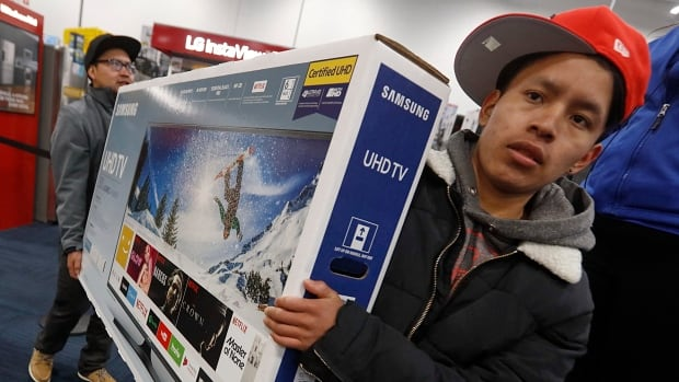 Shoppers wait to make purchases at electronics chainstore Best Buy on Black Friday in Dartmouth, Mass. After two weak holiday seasons in retail sales, U.S. shoppers had spent more than $1.52 billion US online by Thanksgiving evening.