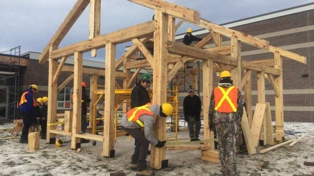 Students from Sioux Lookout finishing up the timber frame structure that will be used as an outdoor classroom at Kingsway Park Public School in Thunder Bay.