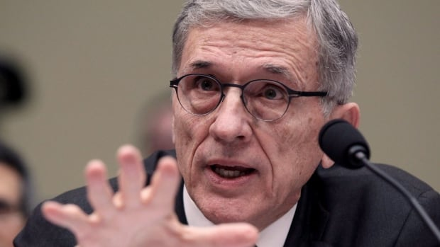 In this March 17, 2015 file photo, then Federal Communications Commission (FCC) Chairman Tom Wheeler testifies on Capitol Hill in Washington. He thinks a proposal to undo net neutrality in the U.S. could have impacts felt in Canada.