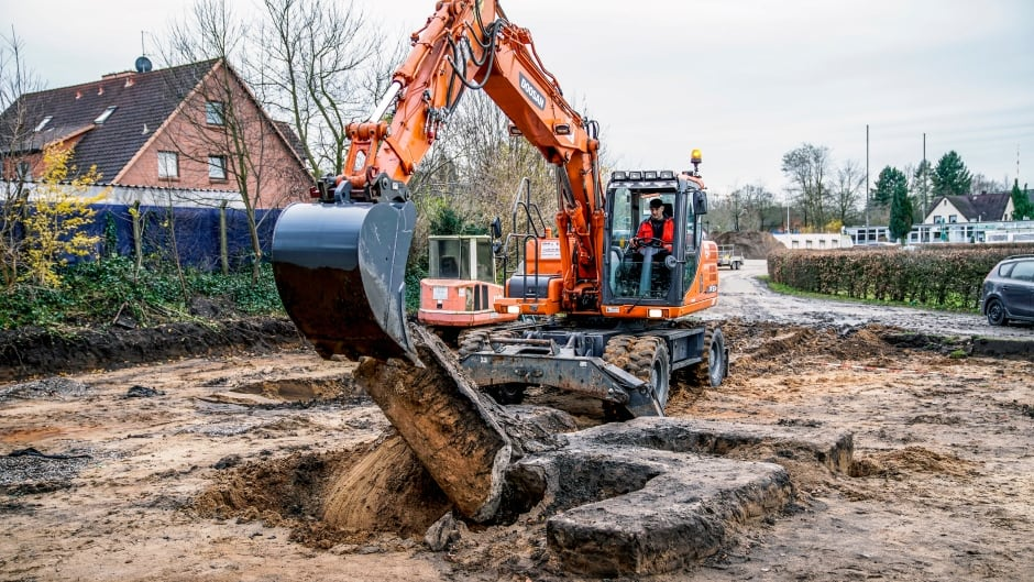 A digger removes a giant concrete Nazi swastika found in a construction site in Hamburg, Germany, on Friday.