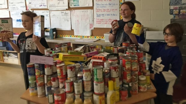 A group of five Grade 5 and 6 students at Prince of Wales Elementary School, including Dakota Stewart, left, Hailey Barriage-Burr and Brandon Alexiuk, collected more than 500 food items for Hamilton Food Share.