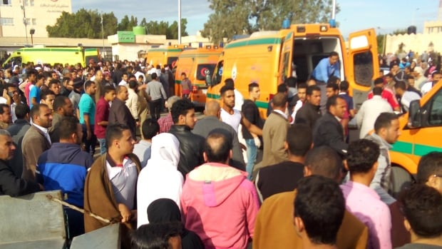 Egyptians gather around ambulances following a gun and bombing attack on al-Rawdah mosque near the North Sinai provincial capital of el-Arish on Friday.