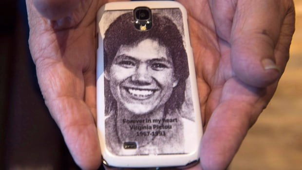 Robert Pictou, father of Virginia Pictou Noyes, displays a phone cover with a photo of his daughter as he attends a hearing of the national inquiry into missing and murdered Indigenous women and girls in Membertou, N.S.