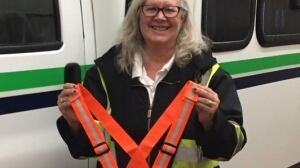 Bus drivers hand out reflective gear to people walking around in dark clothes in Fort St. John