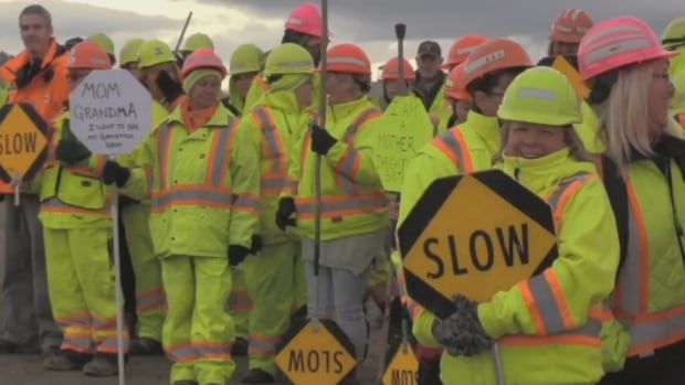 Around 100 flaggers lined Highway 97 near 16th Avenue in Vernon on Saturday, Nov. 25, 2017 to urge drivers to ensure the safety of the workers.