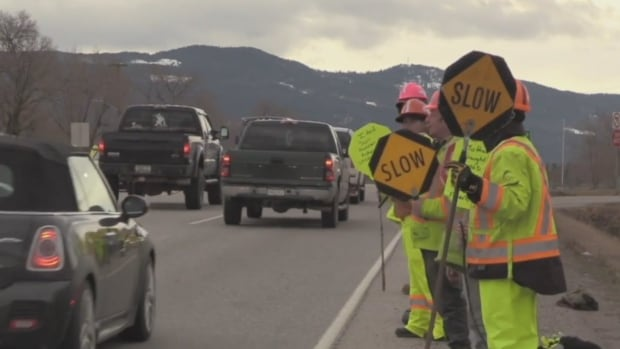 More than 100 flaggers took part in rally in Vernon Saturday to show support for injured worker.