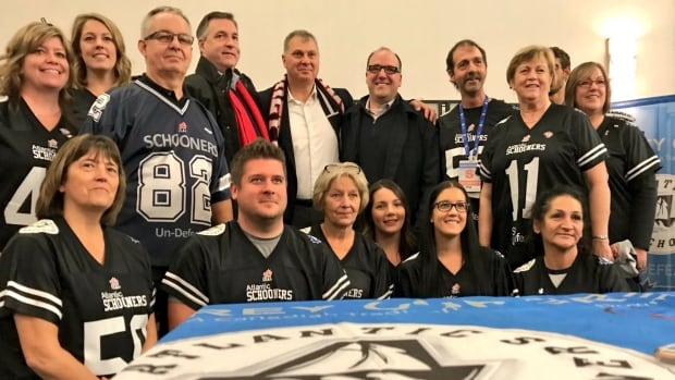 CFL commissioner Randy Ambrosie, centre, meets with Maritime fans during the Atlantic Schooners Down East Kitchen Party last month in Ottawa.