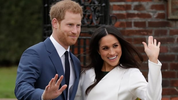 Prince Harry and his fiancée Meghan Markle were all smiles as they met photographers in the grounds of Kensington Palace in London on Monday.