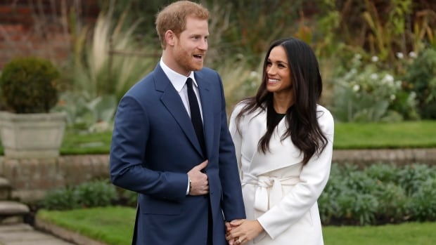 Prince Harry and Meghan Markle pose for photographers on the grounds of Kensington Palace in London on Monday. Their engagement has special resonance for the longtime Suits actress' former fellow Torontonians.