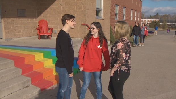 Leading to the future: students paint rainbow staircase at Rothesay High