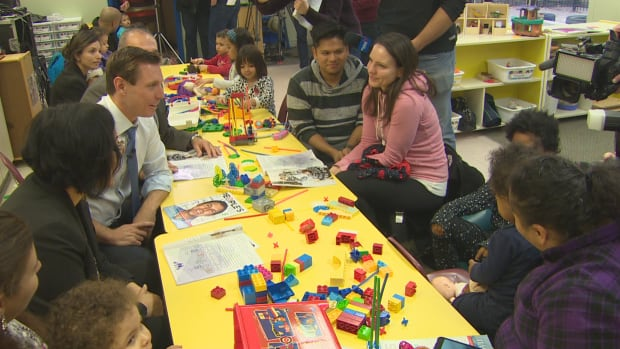 Ontario PC leader Patrick Brown meets with parents and children at the Little Angels Christian Child Care Centre in Mississauga.