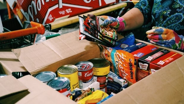 A volunteer packs a hamper at the London Food Bank. A new report from the Middlesex-London Health Unit found that many Londoners don't have enough in their budgets to buy healthy food.