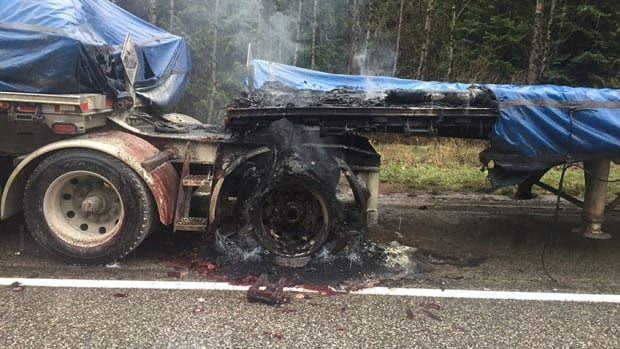 The semi truck caught fire Tuesday morning, spilling corrosive liquid onto the road and into the ditch.