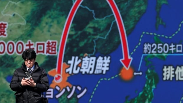 A street monitor in Tokyo on Wednesday shows a news report about North Korea's latest missile launch, on Wednesday.