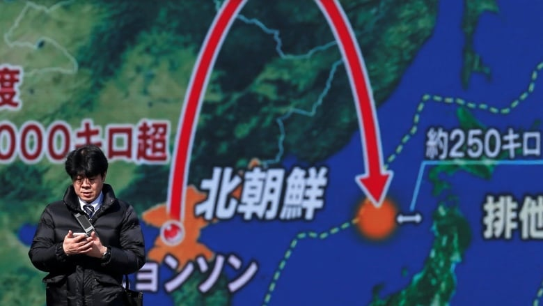 A street monitor in Tokyo on Wednesday shows a news report about North  Korea's latest missile launch, on Wednesday. (Toru Hanai/Reuters)