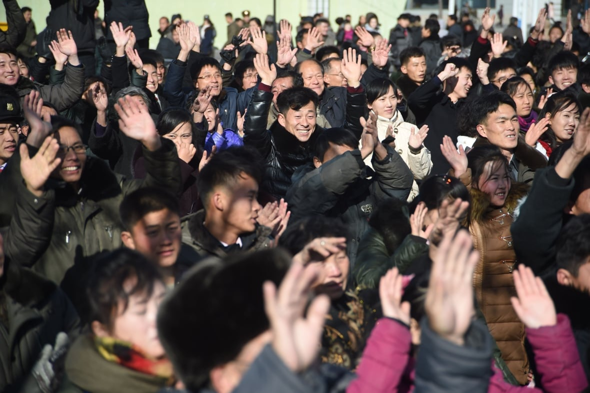 North Koreans react at the Pyongyang Railway Station after the news of the successful launch of the new intercontinental ballistic missile on Wednesday.(Kim Won-Jin/AFP/Getty Images)