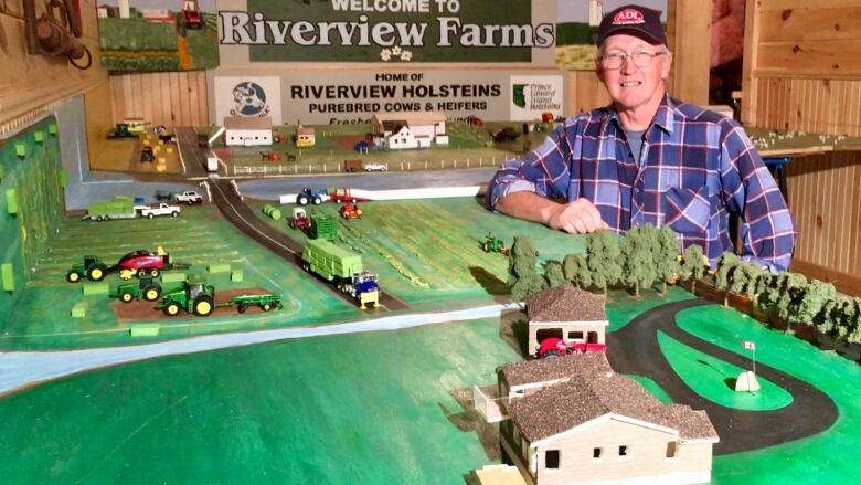 P E I  farmer rebuilding his community — in his basement