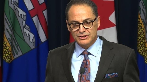Finance Minister Joe Ceci says his fiscal update Tuesday showed Alberta's economy is growing faster than expected and the deficit is dropping, but credit agencies remain unimpressed.