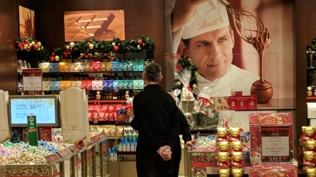 All dressed up for the season, this downtown Toronto candy store has doubled its staff of black-clad employees during the December rush.