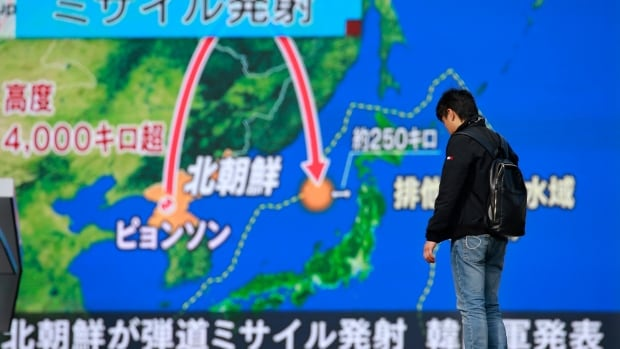 A man stands in front of a screen showing TV news program reporting North Korea's missile launch in Tokyo on Wednesday. In the wake of a series of nuclear and missile tests by the North Korean regime the United States and Canada held joint exercises simulating a nuclear attack on both sides of the border.
