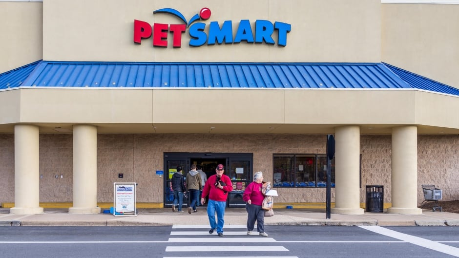 Petsmart store facade with people crossing street
