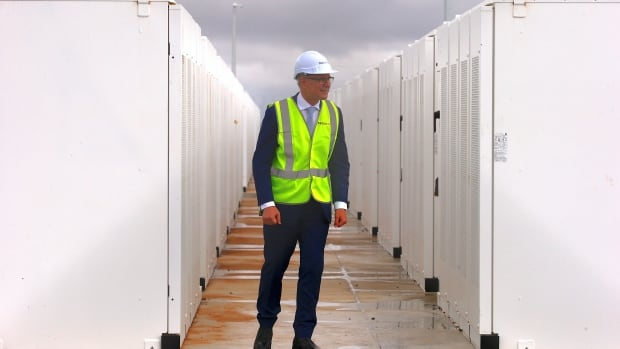 South Australian Premier, Jay Weatherill walks around the compound housing the Hornsdale Power Reserve, featuring the world's largest lithium ion battery made by Tesla, during the official launch near the South Australian town of Jamestown, in Australia, December 1, 2017.