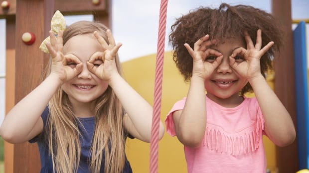 Young children would benefit from celebrating the differences in those from other racial backgrounds, researchers say.
