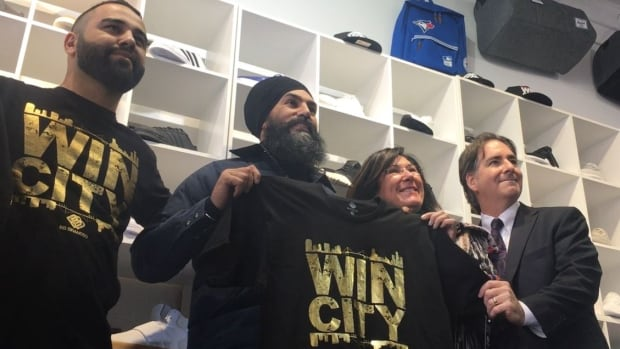 Federal NDP leader Jagmeet Singh, centre, poses at BB Branded with MPs Cheryl Hardcastle and Brian Masse and during a visit to Windsor on Dec. 1, 2017.