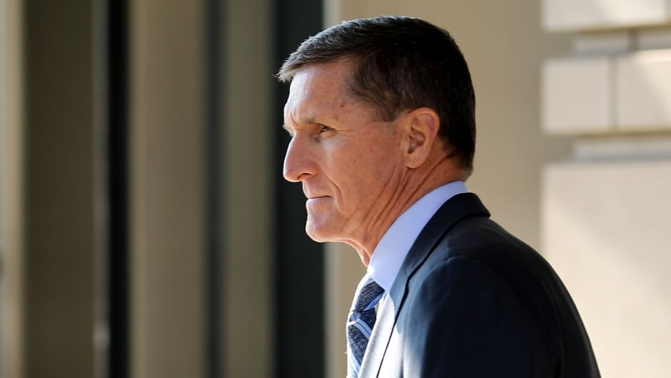 Michael Flynn, former national security advisor to U.S. President Donald Trump, leaves following his plea hearing at the Prettyman Federal Courthouse on Friday.