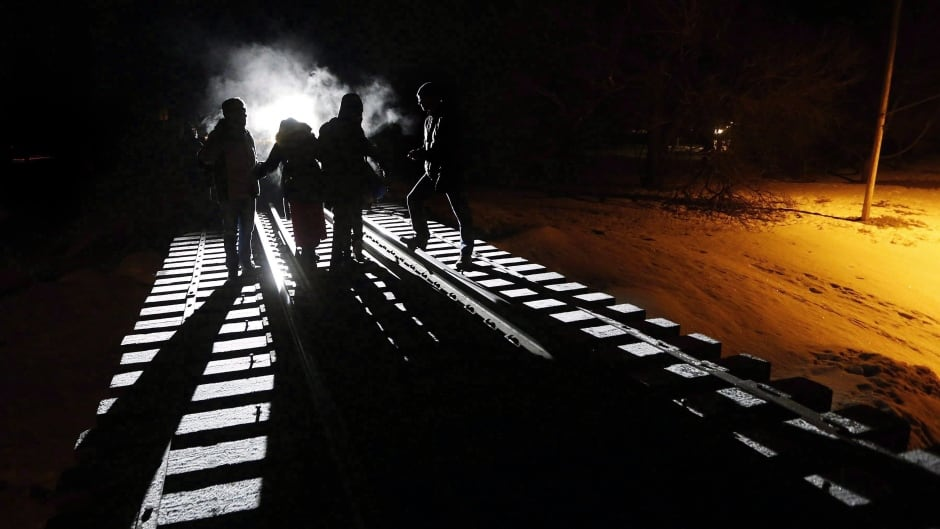 February 26, 2017, eight migrants from Somalia cross into Canada from the United States by walking down this train track into the town of Emerson, Manitoba.