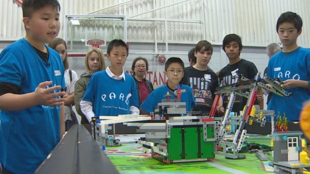 Richard Zhang and his teammates from North Surrey Secondary School showcase their water-conserving robot during the First Lego League Championship Tournament.